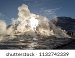 the sun rises behind the geyser ... | Shutterstock . vector #1132742339