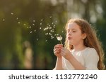 cute curly girl blowing...   Shutterstock . vector #1132772240