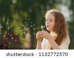 curly girl blowing dandelion in ...   Shutterstock . vector #1132772570