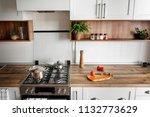 stylish kitchen interior with... | Shutterstock . vector #1132773629