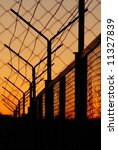 barbed wire on sunset background | Shutterstock . vector #11327839