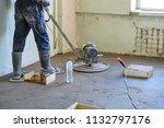 grinding of concrete floor | Shutterstock . vector #1132797176