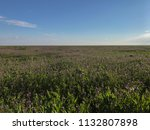huge field and sky with small... | Shutterstock . vector #1132807898