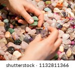 woman holding various tumbled... | Shutterstock . vector #1132811366