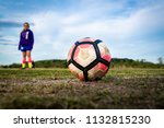 a young girl stands behind a... | Shutterstock . vector #1132815230