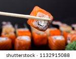 mens hand holding wooden sticks ... | Shutterstock . vector #1132915088