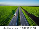 white trucks driving on asphalt ... | Shutterstock . vector #1132927160