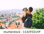 woman and child on background...   Shutterstock . vector #1132932149