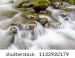 slow shutter mountain stream | Shutterstock . vector #1132932179