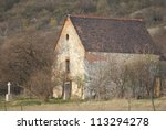medieval catholic chapel on a hill at fall - stock photo