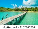 wooden pier or bridge with... | Shutterstock . vector #1132943984