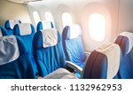 empty airplane seats in the... | Shutterstock . vector #1132962953