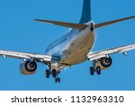 Sharp, close-up telephoto image of aircraft with landing gear down, international airport, Vancouver Island, BC, Canada