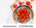 red cherry tomatoes in a sieve.   Shutterstock . vector #1132984286