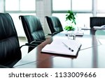 notebook with pen in the... | Shutterstock . vector #1133009666