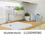 designed kitchen with white... | Shutterstock . vector #1133098580