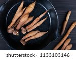 group of fingerroot on dark... | Shutterstock . vector #1133103146