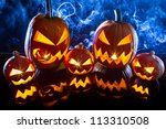 group halloween pumpkins on the ... | Shutterstock . vector #113310508