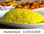 tehar is a yellow rice cooked... | Shutterstock . vector #1133112314