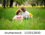 Two Young Children Kissing In...