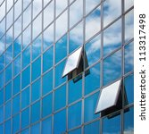 Windows of the modern office building with clouds reflecting. Modern business architecture. - stock photo