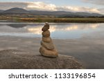 at one with nature  stone pile... | Shutterstock . vector #1133196854