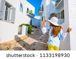 little girl in white hat on a... | Shutterstock . vector #1133198930