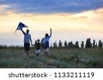 happy family flying kite... | Shutterstock . vector #1133211119