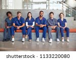healthcare workers sitting in a ... | Shutterstock . vector #1133220080