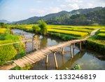 A Wooden Bridge In The Fields...
