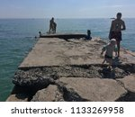 children jumping into the sea...   Shutterstock . vector #1133269958