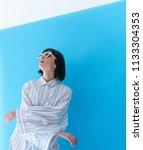 girl model in white dress and... | Shutterstock . vector #1133304353