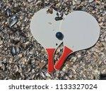 racket beach ball in sand   Shutterstock . vector #1133327024