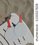 racket beach ball in sand   Shutterstock . vector #1133327828