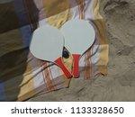 racket beach ball in sand   Shutterstock . vector #1133328650