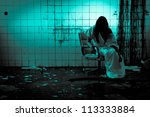 Horror scene of a scary twisted woman - stock photo