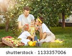 the happy young family during... | Shutterstock . vector #1133357006