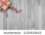 gift with cones on an old wood... | Shutterstock . vector #1133410610