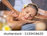 woman lying on a spa bed and...   Shutterstock . vector #1133418620