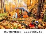 autumn forest hunting hut...   Shutterstock . vector #1133455253