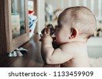 breast child pulls the pill... | Shutterstock . vector #1133459909