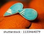 hand made turquoise earrings... | Shutterstock . vector #1133464079
