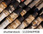 oil drill pipe. rusty drill... | Shutterstock . vector #1133469908