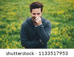 man posing in the field  smiling | Shutterstock . vector #1133517953
