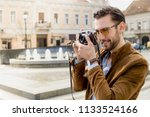 a handsome  young man traveler  ... | Shutterstock . vector #1133524166