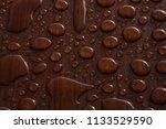 raindrops on wood surface  | Shutterstock . vector #1133529590
