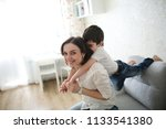 mom and son together  gentle... | Shutterstock . vector #1133541380