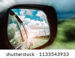 reflection of the road in the... | Shutterstock . vector #1133543933