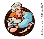 cheerful cook with fish.... | Shutterstock .eps vector #1133567399