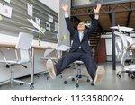 a businessman is riding an...   Shutterstock . vector #1133580026